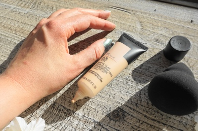 the body shop clay foundation blended swatch